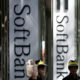 Shop employees of SoftBank Corp work outside its branch in Tokyo